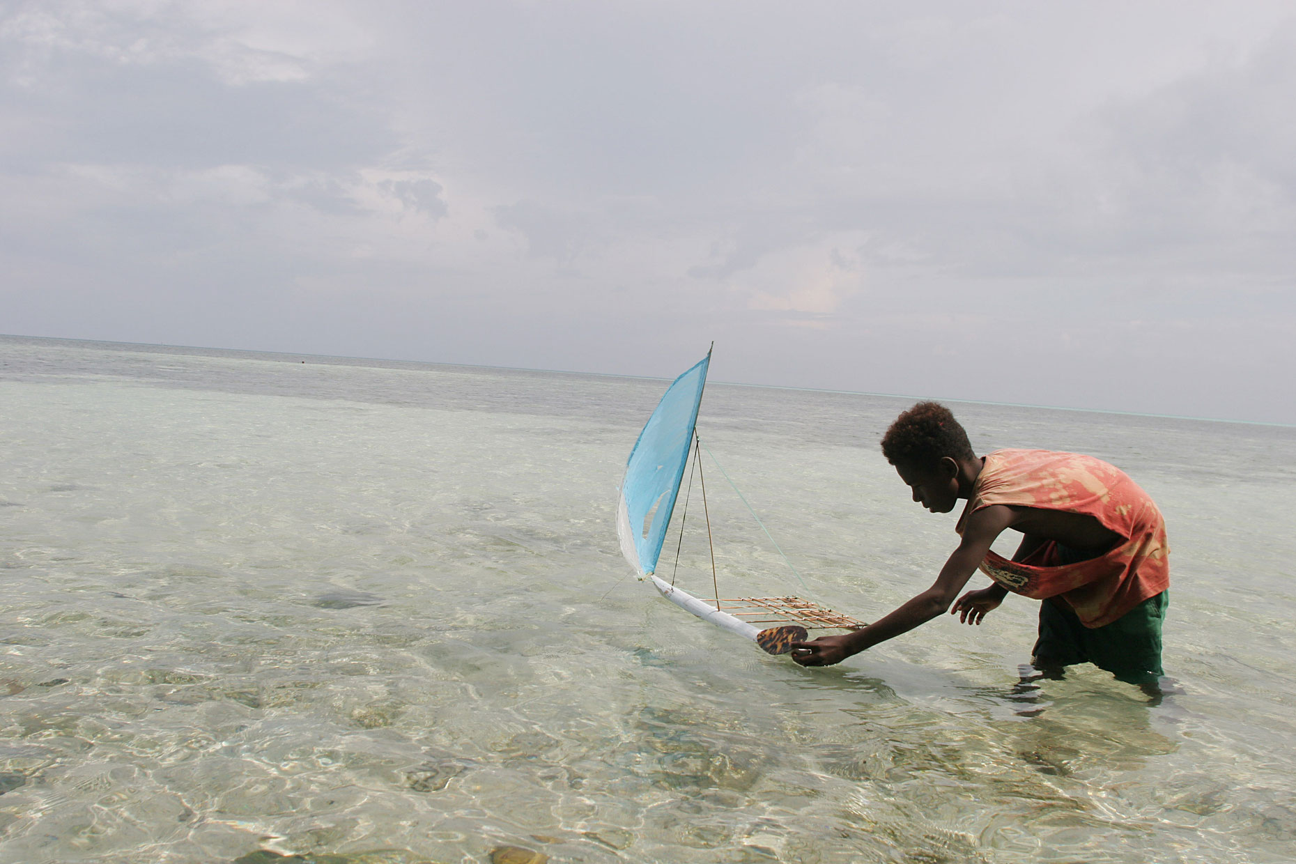 Toy boat in Pacific Atoll, by Scotland Greenpeace photographer