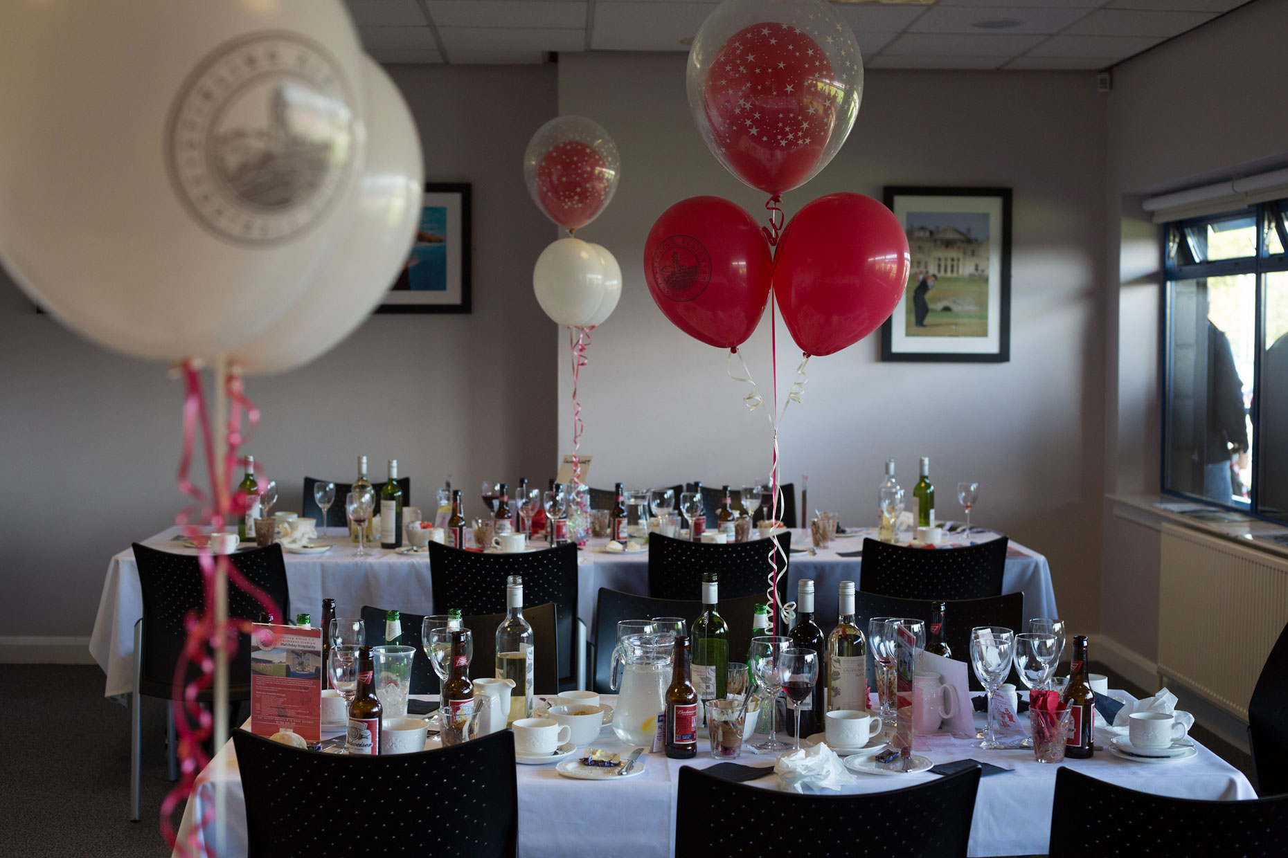 Ballons and dinner table at football club, Scotland, by photographer Sutton-Hibbert