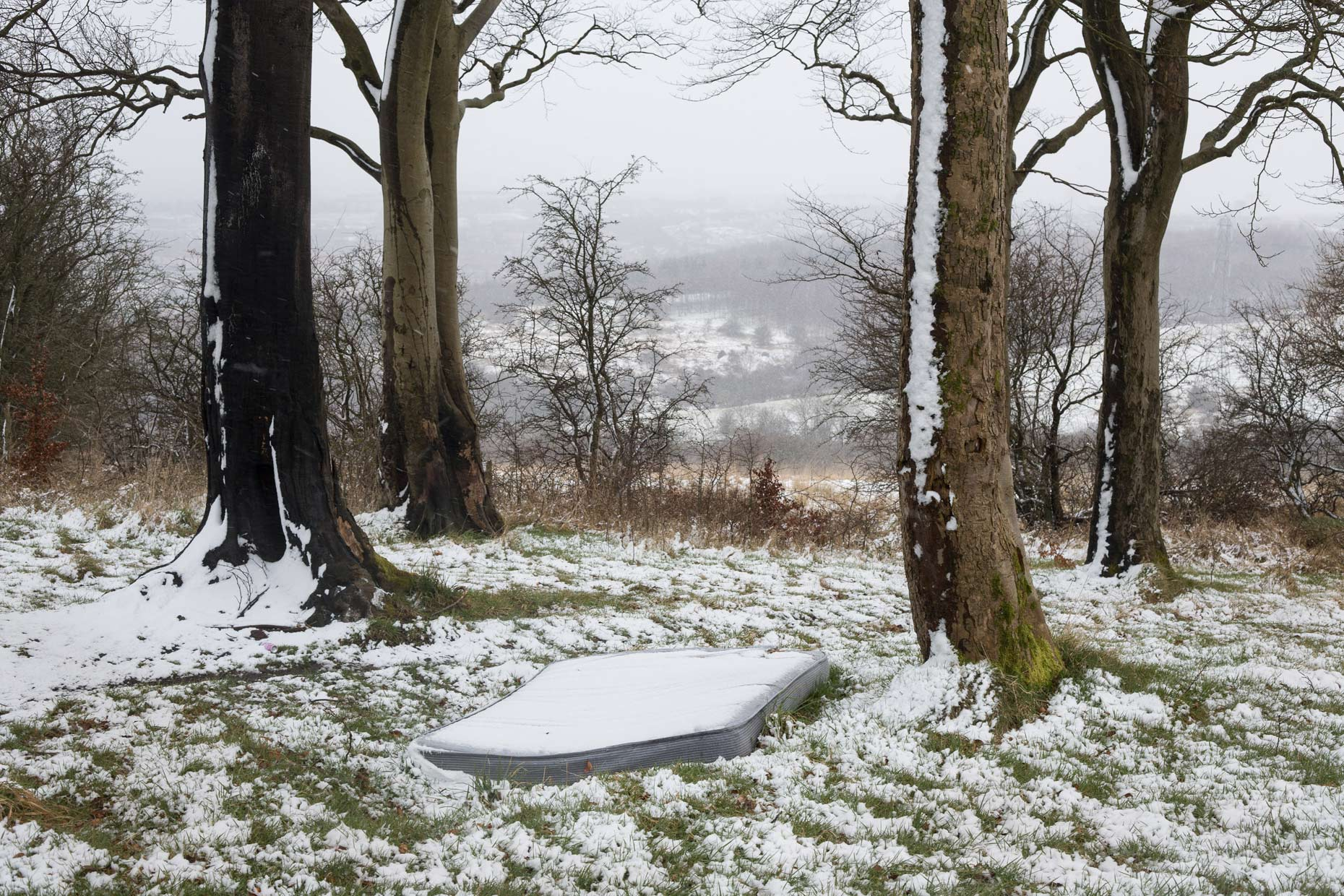 Mattress in the snow on Antonine Wall, Scotland by Glasgow photographer Sutton-Hibbert