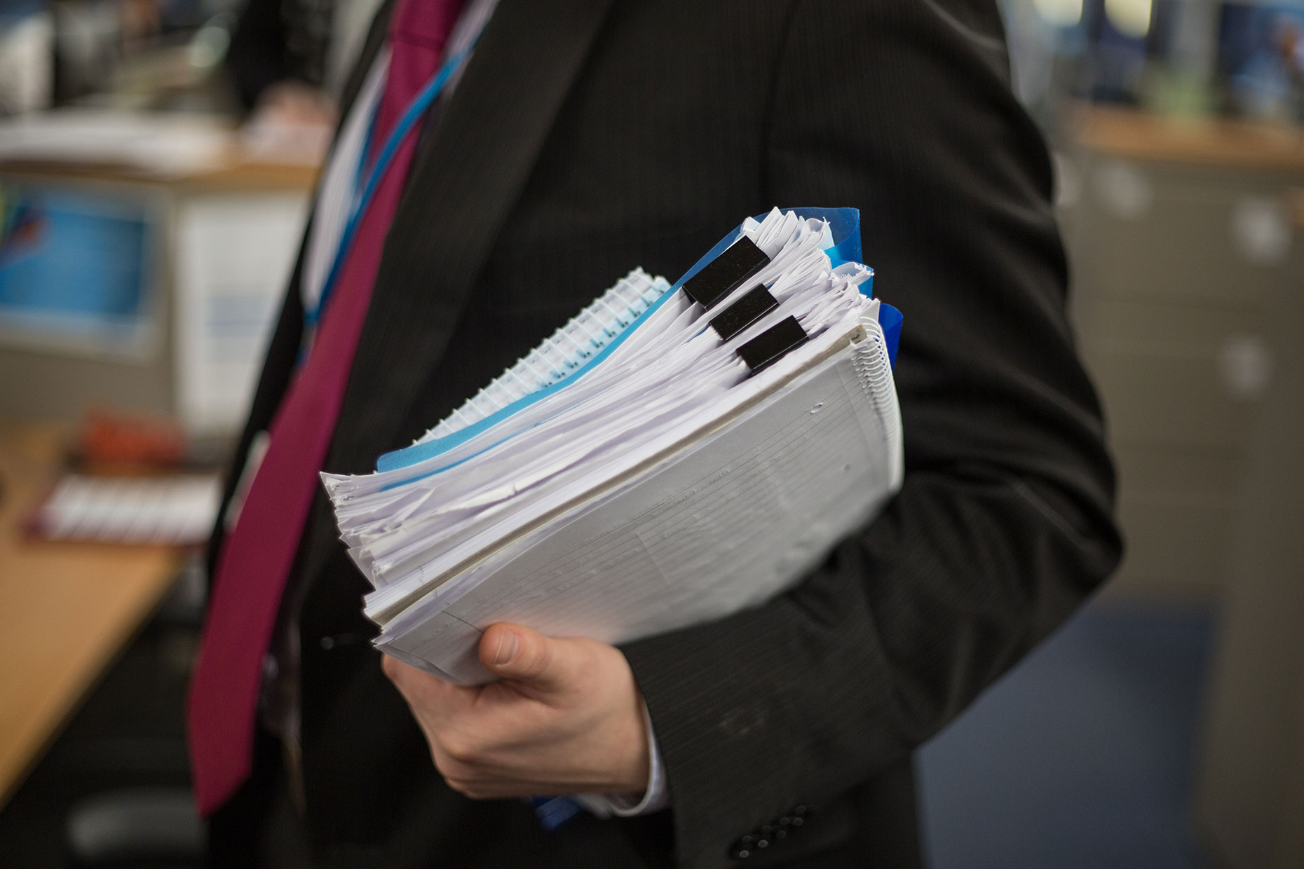 Businessman carried files by Scotland corporate photographer J. Sutton-Hibbert