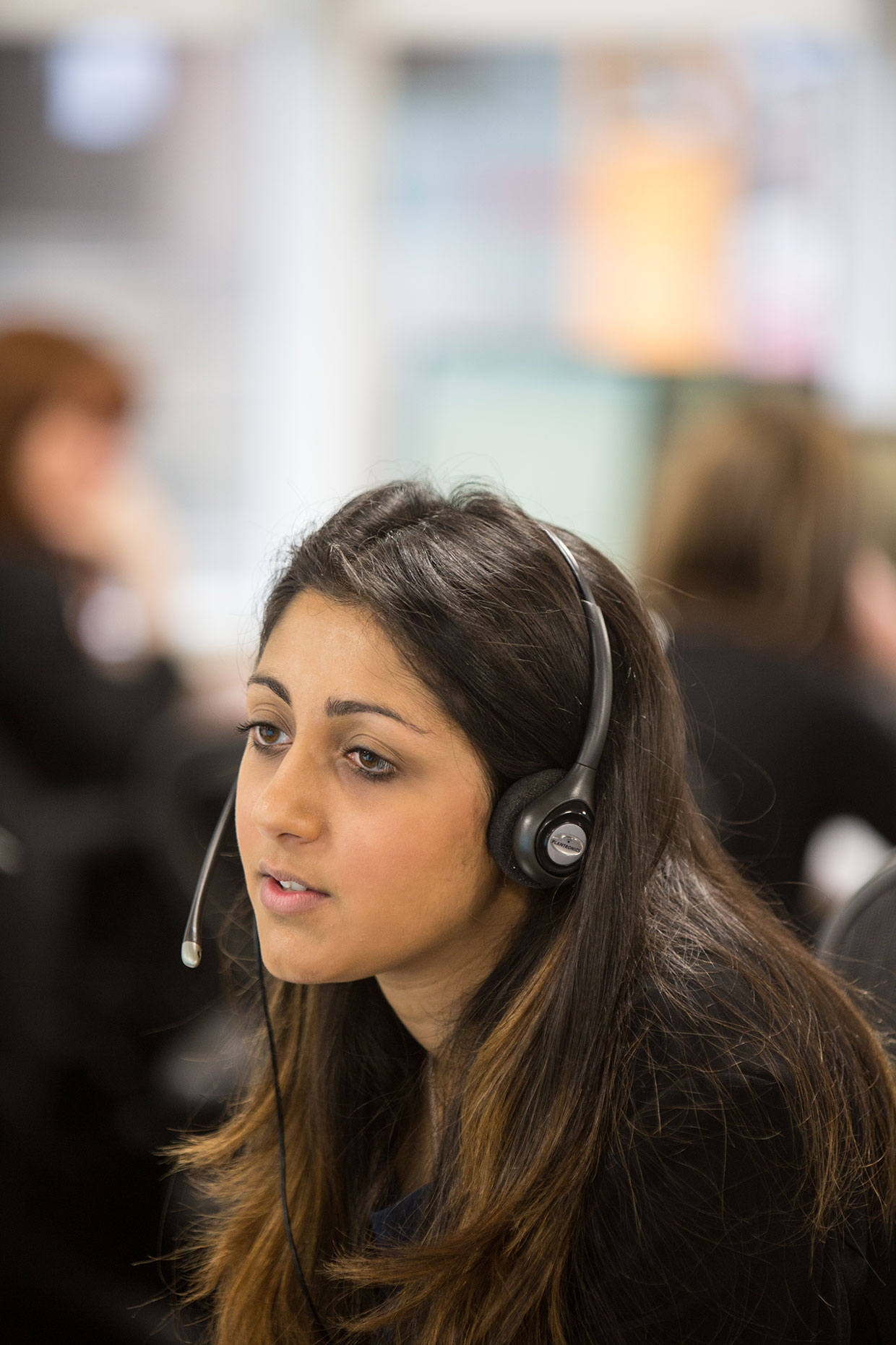 Woman on phone call at Barclays Bank, Scotland, by photographer J. Sutton-Hibbert