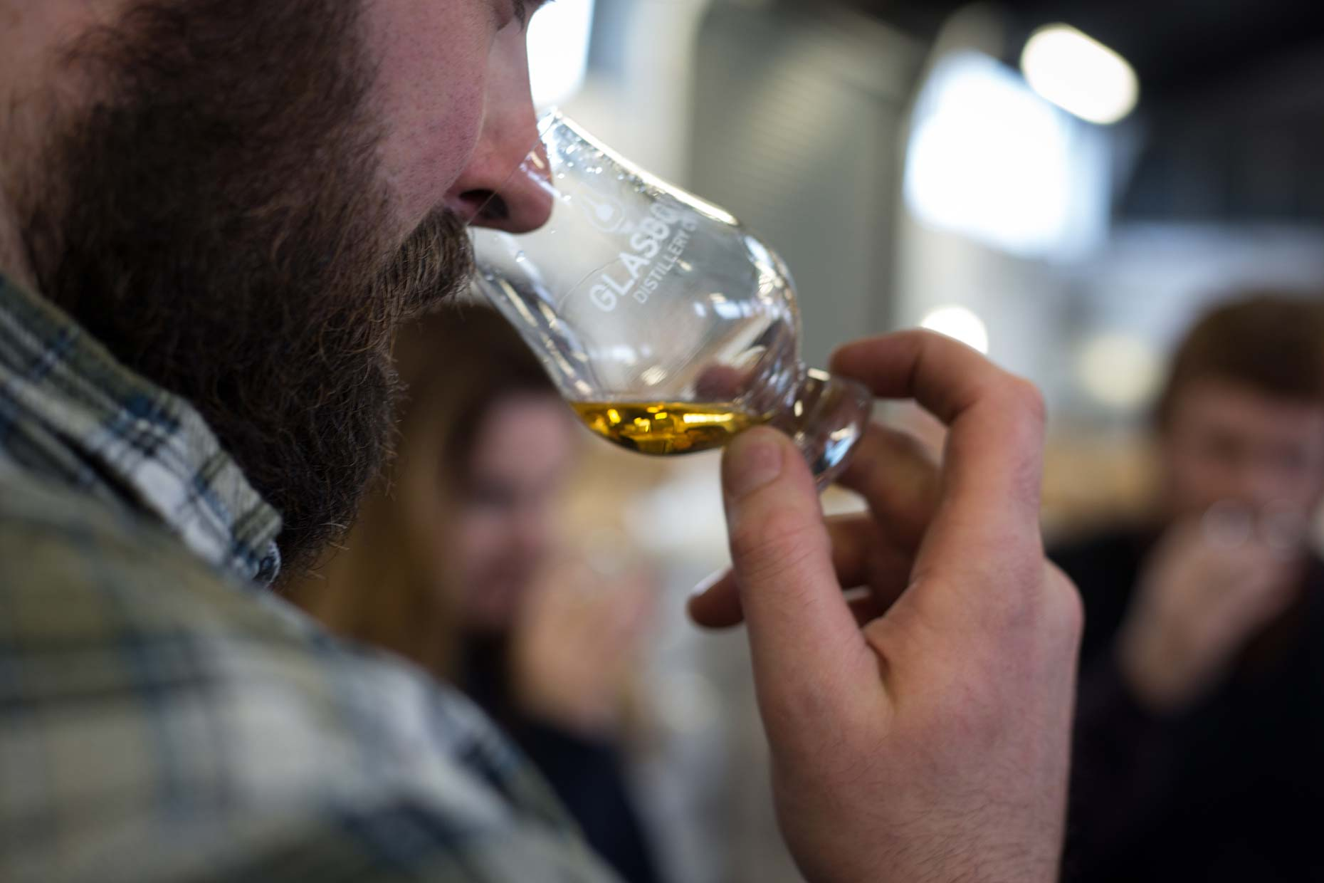 Nosing a dram of Scottish single malt whisky, Scotland