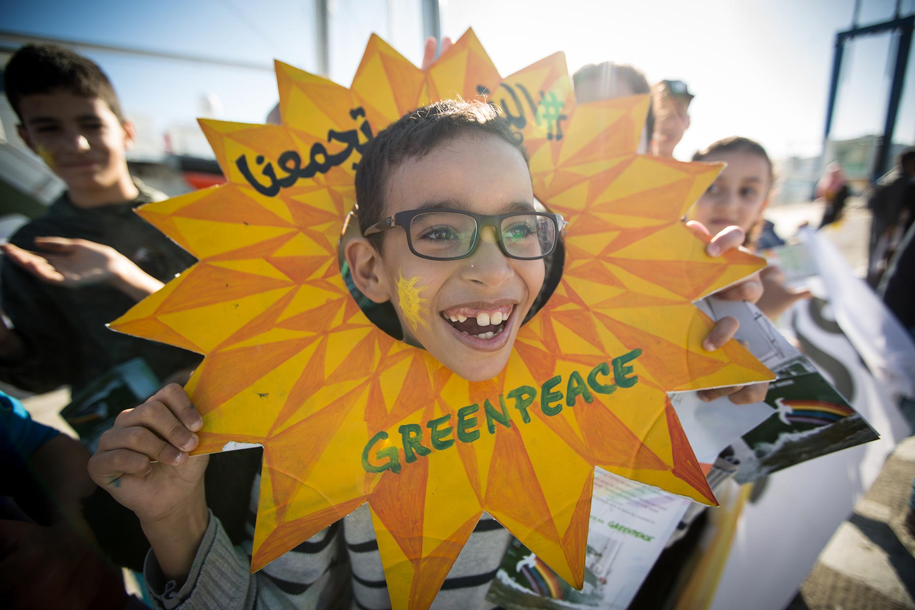 Greenpeace boy with sun, by Scotland photographer