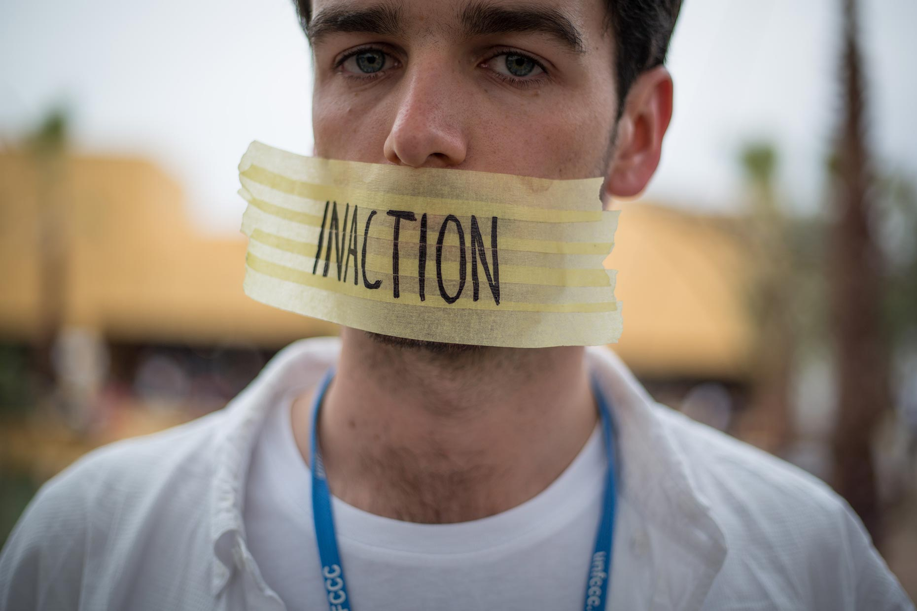 Inaction written on tape over mouth, by Scotland Greenpeace photographer