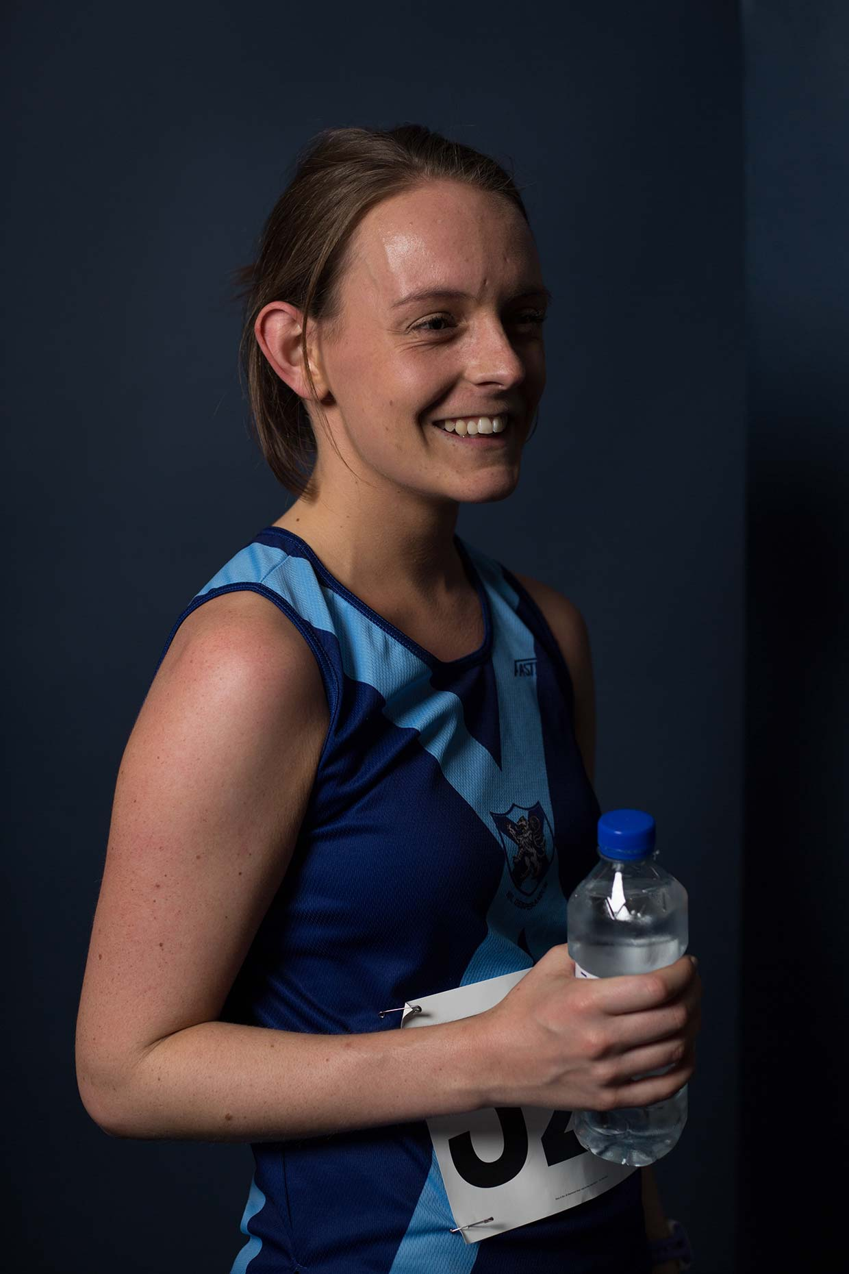 Portrait of female runner at Bellahouston Harriers running club, by Scotland photographer