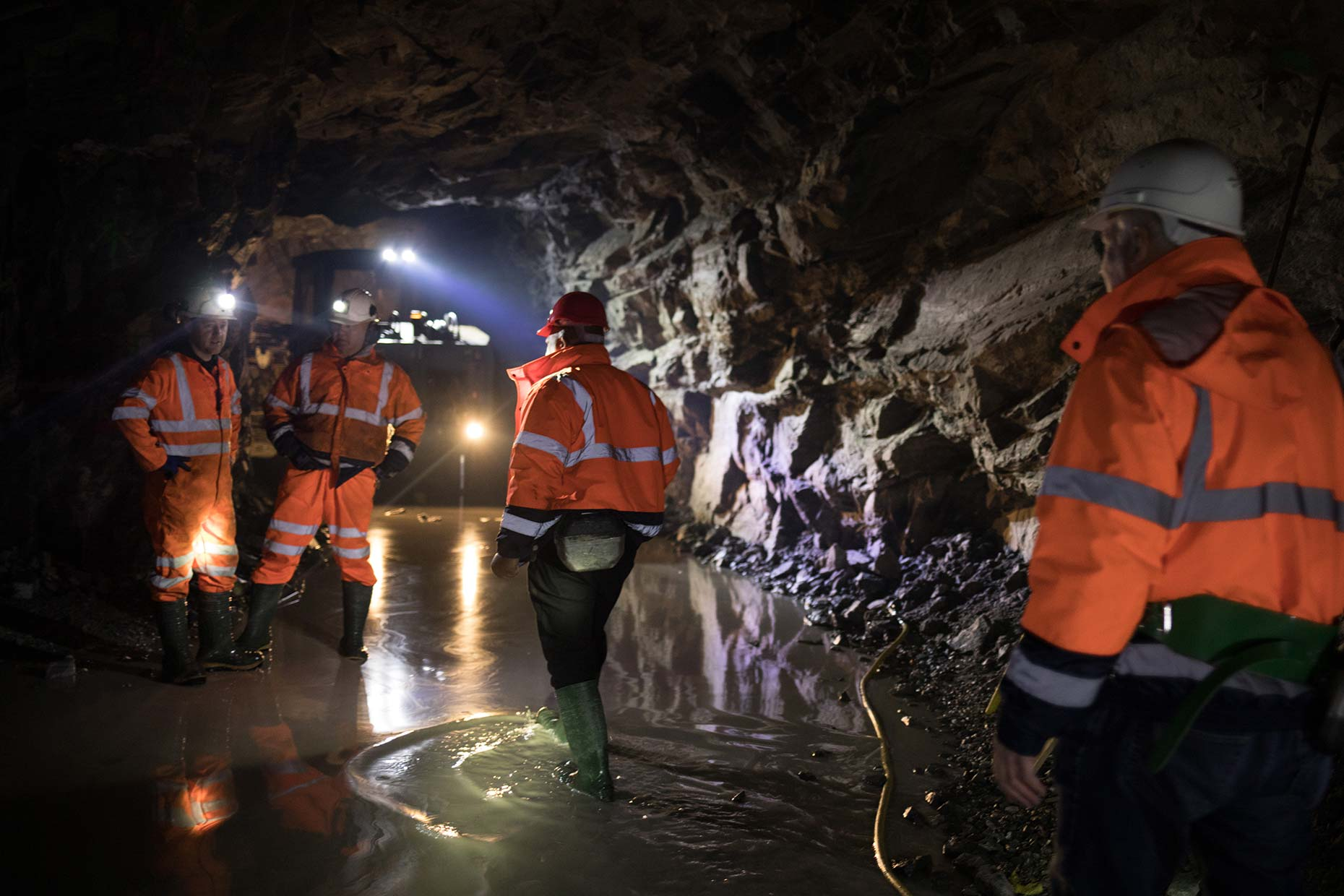 Workers underground in Cononish gold mine, Scotland.