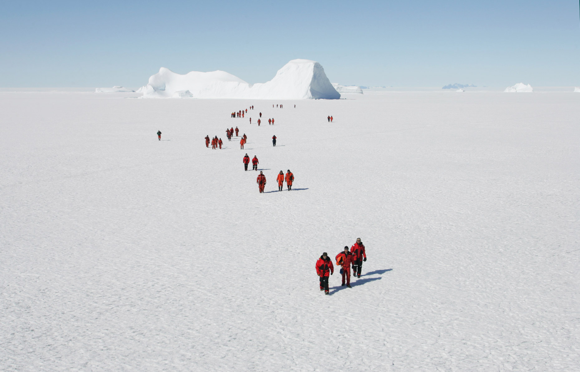 People walk across the Antarctic ice shelf, by Scotland Greenpeace photographer