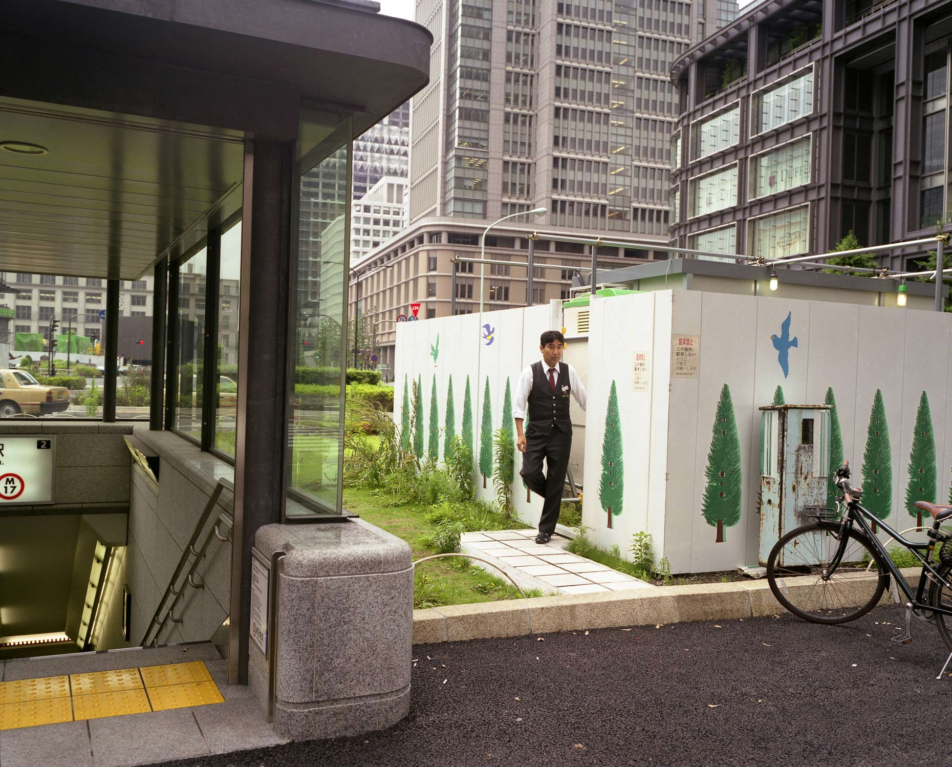 hoardings decorated with tree motifs, Tokyo, Japan.
